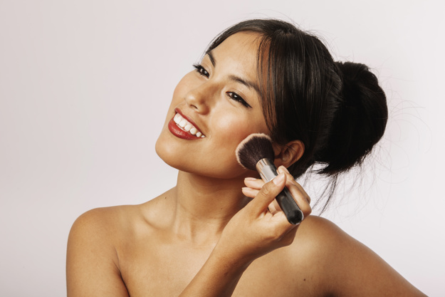 happy-woman-with-facial-make-up_23-2147655370.jpg