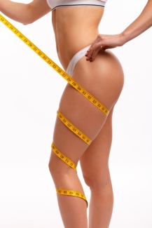 woman-with-a-tape-measure-wrapped-around-her-leg_1208-95.jpg